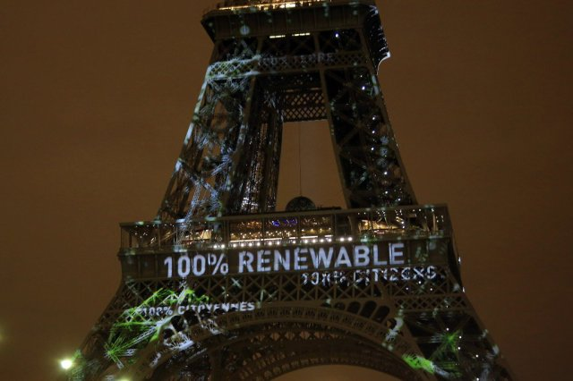 An artwork entitled 'One Heart One Tree' by artist Naziha Mestaoui is displayed on the Eiffel tower ahead of the 2015 Paris Climate Conference, in Paris. (AP Photo/Thibault Camus)